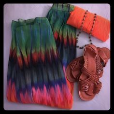 🌈Vince Camuto Maxi Skirt This listing is for one Gorgeous flowing rainbow maxi skirt with side zipper. Other items are not included. Skirt only! Vince Camuto Skirts Maxi