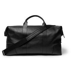 <a href='http://www.mrporter.com/mens/Designers/Shinola'>Shinola</a>'s bag is crafted by one of the label's 68 in-house leather specialist artisans. This black textured-leather duffle style is subtly embossed with a designer stamp and has reinforced corners at the base. Lined in durable grey canvas, it has patch and zipped pockets, as well as a slot for your credit and business cards.