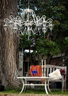 Upcycled solar light. chandelier..Inspiring image only  Link to original source does not work.  Shown on blog Dishfunctional Designs.