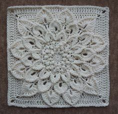 Free Ravelry Crochet Pattern: The Crocodile Flower...this is a 12 in. square, would be great for pillows or as a blanket. Lots of color options, I just love the white though.