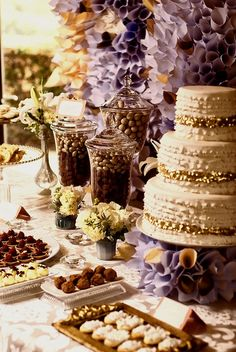 There's no secret that girls love chocolate. At least this stylish cake and dessert table reflects a chocolate loving bride (and maybe groom too?). YUM!