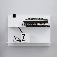 Design Letters' White Paper wall shelf features thin steel shelves that give it a lightweight and streamlined expression. The minimalist, geometrical shelves are perfect for storage and decoration in the living room, kitchen, hallway and bedroom alike. Monochrome Interior, Black And White Interior, Black And White Prints, Wall Hooks, Wall Shelves, Danish Design Store, Lettering Design, Design Letters, Design Bestseller