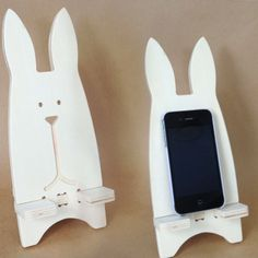 This wooden mobile phone / book holder is a white rabbit. he looks great on any desk or table and is even big enough to hold an ipad mini or ipad / tablet.