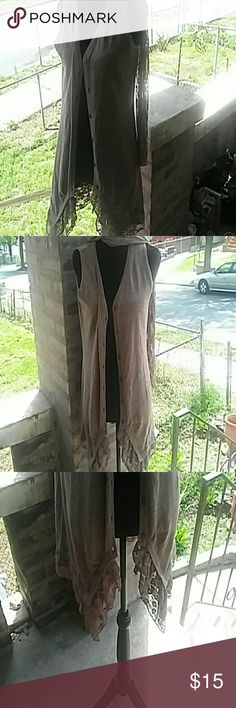 Rancho Estangla. Brown sleeveless sweater. L Rancho Estangla  Brown sleeveless sweater with. Croqueted  scarf.  Croquted on bottom laced.  It goes low.to high on the bottom of. Sweater. This sweater was preowned with love Sweaters
