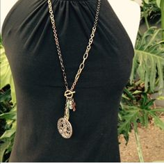 """ANTIQUE style necklace! UNIQUE ANTIQUE STYLE STATEMENT PIECE!29"""" chain length; (35"""" overall length with attachments). One key, one religious medallion, an angel wing, a cross, and a pretty crystal fob. Chain is multi colored in various metal shades. Clasps at front, Photo #3 is if the back. Note that this is NOT vintage. WE ACCEPT OFFERS/GIVE BUNDLE DISCOUNTS; USE THE OFFER AND BUNDLE FEATURES, PLEASE. BE KIND. Boutique Jewelry Necklaces"""