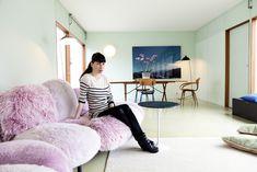 minty walls. pink marshmallow sofa. okay. // Nina Pohl via the selby