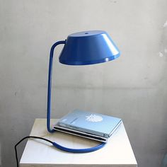 The Desk Aluminium Lamp is small in size, with a clean and contemporary silhouette.  This unique, entirely handmade lamp is influenced by the vintage style