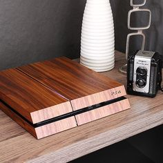 Get your game-style on! Toasting your Sony PlayStation 4 takes it from toyland to totally legit. Wrap your PS4 in gorgeous real wood, cut from one piece of veneer for perfectly matched grain patterns that create a seamless look. All of our PS4 covers are cut by actual lasers and finished by hand for sweet perfection. The full kit covers the front, top, and sides of the unit. Our covers look rad whether you like your PS4 horizontal or use the vertical stand. All the vents are left fully…
