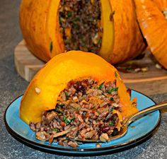 Tender, sweet, baked stuffed pumpkin with a delicious mixture of rice, vegetables, nuts & cranberries. A beautiful centrepiece for your Thanksgiving gathering!