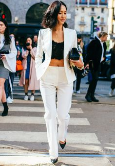 9 Pitch-Perfect Lessons in How to Wear a Crop Top - - How to wear a crop top and look on trend for Well, we've hunted down nine different looks that work for everyone. See and shop them all here. Cropped Tops, Lace Crop Tops, Crop Top Hoodie, Crop Top Elegante, White Pantsuit, How To Wear Shirt, Smoking, Summer Wedding Outfits, Summer Outfits