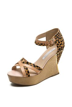 DVF | The Alara is a strappy, architectural wedge perfect for work or the weekend.   http://on.dvf.com/198b4P6