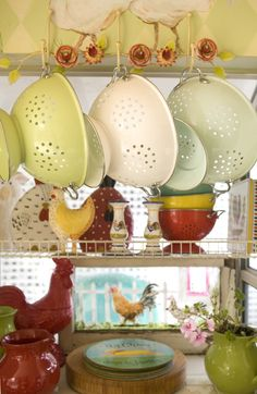 Hang pots, colanders and pans from above to save counter space. (Photo by Jaimee Itagaki) Kitchen Display, Kitchen Decor, Kitchen Dining, Cottage Kitchens, Country Kitchens, Rose Cottage, Yellow Cottage, Cottages And Bungalows, Country Decor
