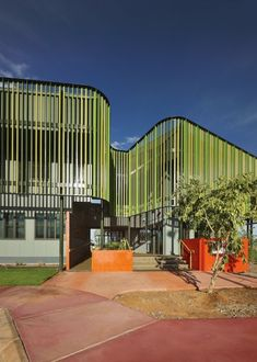 MG/GT Administration Building : Coda Studio Colourful Buildings, Building Exterior, Facade Design, Urban Design, Eco Friendly, Places To Visit, Deck, Community, Playgrounds