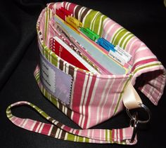 Large Coupon Organizer Budget system, wristlet, striped fabric, hooks to cart,  works for Dave Ramsey Cash System too. $27.95, via Etsy.