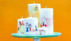 Super Tutorial. I have stamped tissue paper and it works great, too. Fun for the whole family or as beautiful gifts. Pillar candles Wax paper Copy paper Sharpie permanent markers Tissue paper Glue sticks Scissors A hair dryer