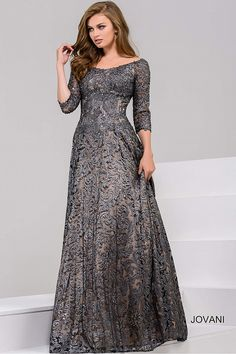 Gorgeous floor length A-line metallic gunmetal lace evening gown features corset bodice with off the shoulder neckline and three quarter sleeves.