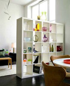 Love the shelf as a room divider.... You could leave cubbies to see through.
