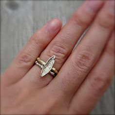 A real twig is cast in solid recycled gold to create the unique ring shank. Set atop the branch is a hand-carved leaf, flowing and organic in form.