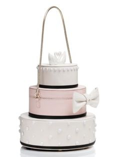 for the kind of girl who's not afraid to commit (to her true love, of course, but also to a theme) this bag--which looks almost exactly like a three-tiered wedding cake--is the perfect purse to carry Unique Handbags, Unique Purses, White Clutch, White Handbag, Wedding Accessories For Bride, Bridal Accessories, Diy Lace Garter, Belle Cake, Fab Bag