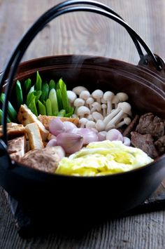 Sukiyaki - Japanese Hot Pot. Had this w/ friends to ring in the New Year: delicious, fast, healthy, warm in your belly, and very different. Like Fondue, it's great for bringing people together over a common bowl: dinner and a show!
