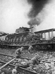 Germans advancing near a russian KV-1 tank. Smolensk, Russia. 1941.:
