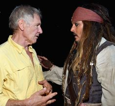 "ANAHEIM, CA - AUGUST 15:  Actors Harrison Ford of STAR WARS: THE FORCE AWAKENS (L) and Johnny Depp, dressed as Captain Jack Sparrow, of PIRATES OF THE CARIBBEAN: DEAD MEN TELL NO TALES took part today in ""Worlds, Galaxies, and Universes: Live Action at The Walt Disney Studios"" presentation at Disney's D23 EXPO 2015 in Anaheim, Calif.  (Photo by Alberto E. Rodriguez/Getty Images for Disney) *** Local Caption *** Harrison Ford; Johnny Depp"