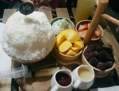 Patbingsu is a Korean shaved ice dessert with sweet toppings such as chopped fruit, condensed milk, fruit syrup, and Azuki beans. The snack is highly popular in Korea. The food originally began as ice shavings with red bean paste.