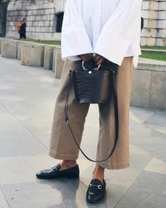 Minimal and stylish : gucci loafers, oversized shirt, pale trousers.