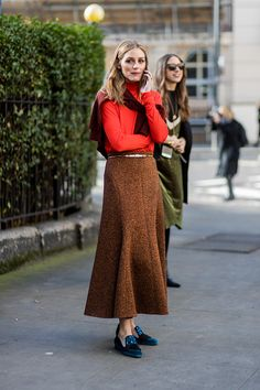 Olivia Palermo wearing an orange red longshirt brown skirt outside Pringle of Scotland on day 4 of the London Fashion Week February 2017 collections...
