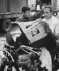 Chic barber Jay Sebring, working on actor Paul Newman's hair while he is reading the paper, sitting on motorcycle (only seat available) on the set of the film Moving Target outside sound stage at Warner Bros. Studio. (Photo by Don Cravens//Time Life Pictures/Getty Images) Don Cravens