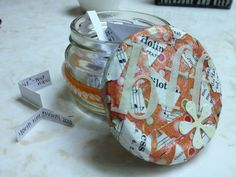 A DIY mini mason jar with a modge podged lid to hold memories! Great gift for friends and family!