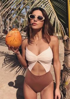 Don't know what to do with your hands? Grab a coconut, a sun hat, a beach bag—anything. Love these sunnies too...