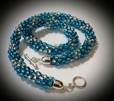 Sold out! Come and visit my shop for more fabulous gift ideas. Kumihimo Necklace Beaded Blue and Silver by MyIslandDream on Etsy