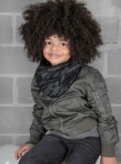 Male kid model wearing handmade cozy and warm alpaca lightning bolt cowl in pebble mix and onyx from DeNada's 2016 Autumn/Winter Kids Collection. This printed cowl is designed in Washington, DC and hand-knit in Peru with a soft alpaca blend yarn. Photo by Emma McAlary.