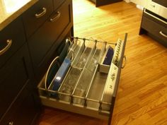 Good idea for storing casserole dishes.  Always have a hard time finding a place for these.