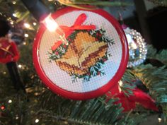 One of the earliest ornaments I ever made to gift to my nieces and nephews... around 1997 Counted cross stitched bells with ribbon and bead embellishments from Leisure Arts