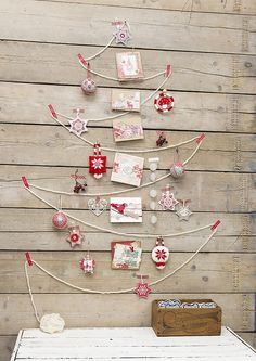 Pretty and simple - rope, clips and ornaments against bare wood.