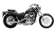 2001 Honda Shadow Deluxe.   Good beginner bike - esp. for women.   Can easily go 80 mph and is heavy enough to not be blown around.  Negative: doesn't get up to speed fast.  #motorcycle #Honda