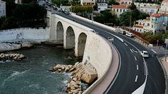 Stock Footage |long exposure time-lapse shot of traffic on the bend in the corniche road, marseilles | License and download using the VidLib iOS app with over 100.000 Royalty Free Clips