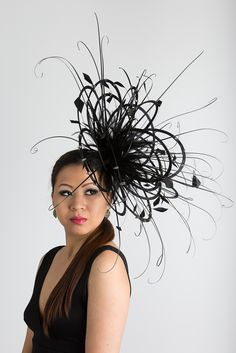Black large fascinator with studs and soft curled quills 6fb5dd42d82