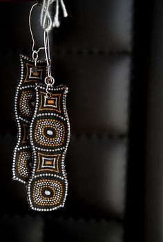 Earrings made from scraps of shweshwe fabric.