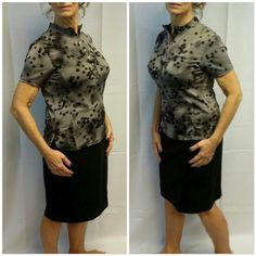 Black n gray print pull over with snaps size M Black n gray print pull over with snaps size M, silky slinky, side slits, top pocket, stitched seams up both sides of front. See 4th picture for measurement. Polyester spandex blend. Great everyday blouse or with that power business suit. Tops