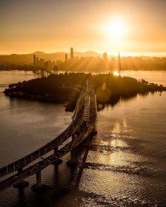 San Franciscos Bay Bridge and that beautiful SF Skyline by Brandon Taoka by photoblog.sanfranciscofeelings.com sanfrancisco sf bayarea alwayssf goldengatebridge goldengate alcatraz california