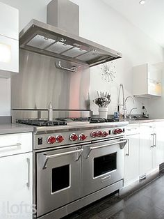 6 burner gas stove...i will get this stove in our next house!!  Red knobs and all