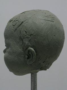 sculpture luar olur sculptor 10 cm. clay