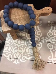 """Inspiration piece... Farmhouse Swag Beads """"Painted loop Navy with Tassel"""" Wood Bead Garland, Diy Garland, Beaded Garland, Bead Crafts, Diy Crafts, Wood Block Crafts, Decorative Beads, Rustic Crafts, Wooden Beads"""