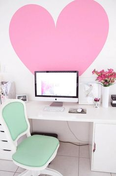 giant PR pink heart and  chair in the office with a white desk