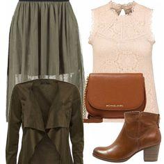 Per un look semplice e casual, gonna lunga verde militare, abbinata a un top rosa chiaro, stivaletti e borsa di cuoio, giacca in finta pelle verde militare. Adatto nel tempo libero!