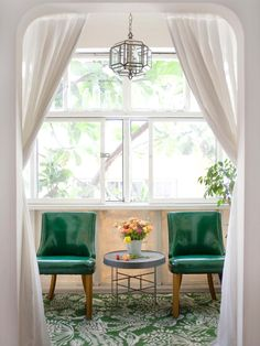 The small sunroom is given a burst of color and pattern with the vintage-inspired carpet and '50s vinyl chairs. Simple sheers have been added to the entryway for privacy and separation.