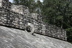 Photo by Andrew Evans, National Geographic Traveler A stone ring hangs on the slanted edges of the ball court in the ruins of Coba, Quintana Roo, Mexico. Ball players tried to shoot a rubber ball through the horizontal hoop--the first team to succeed was the winner of the game. Ball courts took on many different dimensions and sizes and the sheer number of courts show the importance of the sport in almost every era of Maya civlization.